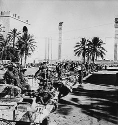 British Valentine II or IV infantry tanks lined up in Tripoli, Libya after they helped capturing the city, circa mid to late Jan 1943