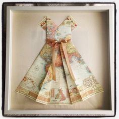 Framed paper map dress. Perfect for Thursday's child, for she has far to go.