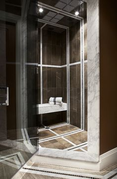 Brown Marble Shower by Terra Verre, via Flickr. Great high contrast, stripes of white tile, dark and lighter browns.
