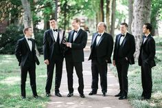 Real Nashville Wedding captured by Jen & Chris Creed! Groom and groomsmen wearing our slim-fit black Ike Behar peak lapel tuxedos. #selectformalwear #blacktux #slimfit #classic #tuxedo #menswear #groomattire #groomsmenattire