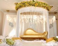 White fabric can be used for walls behind the seating of bride and groom