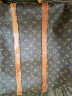 After one side cleaned. Not conditioned just cleaned. Louis Vuitton Keepall bandouliere 55