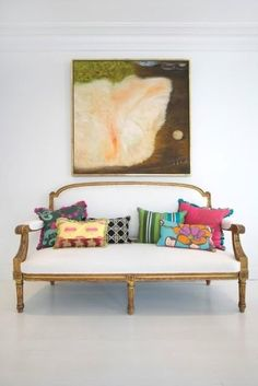 sweet antique settee with modern, colorful patterned pillows - adorable!