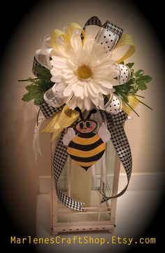 This stunning Bumble Bee/Daisy Lantern Swag / Lantern Bow is pictured on a 20 in Lantern. The lantern swag features a wooden Bumble Bee that