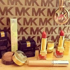 """Maybe went on a little """"me spree"""" on Sunday! Michael Kors tote bag, Estee Lauder lipsticks and eye pot, Clinique gloss ^_^"""