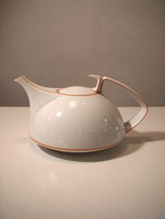 Walter Gropius was a German architect and art educator who founded the Bauhaus school of design, which became a dominant force in architecture and the applied arts in the 20th century.  This teapot is from 1969 and manufactured by Rosenthal studio line