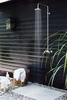 outdoor shower against black backdrop