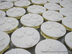 Selection of icing cross and buttercream communion cupcakes