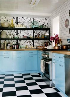 Black and white floor, blue cabinets