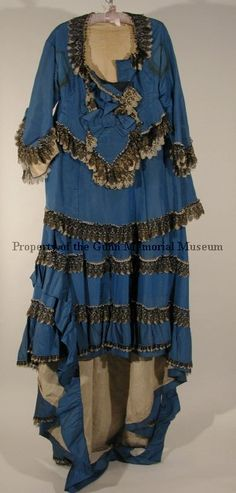 Two-piece dress, royal blue, trimmed with black and white lace. Gunn Memorial Museum