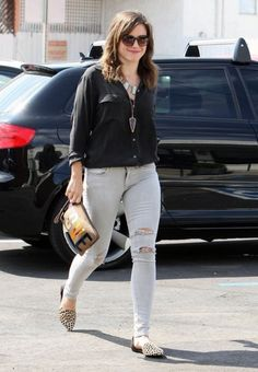 """Sophia Bush wore a pair of Rag & Bone skinny jeans in Surry with holes. I like that she kept most of the outfit simple, wearing them with a black blouse, but she added some interesting accessories like her animal print flats and her """"Love"""" clutch."""
