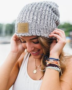 This beanie is knit out of 100% cotton yarn in natural and black colors and features an olive leather patch that is debossed with the Love Your Melon logo. Made in the USA, machine washable, durable.