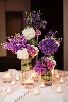 Purple wedding centerpiece idea; Featured Photographer: Jayd Jackson Photography