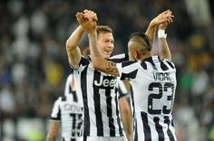 Arturo Vidal and Stephan Lichsteiner of Juventus FC celebrates the goal of 2-0 during the Serie A match between Juventus FC and AC Cesena at Juventus Arena on September 24, 2014 in Turin, Italy.