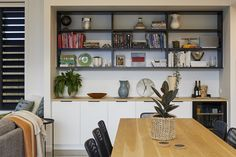 Integrated cabinetry features in this homes dining space. Calley Homes Loft Spaces, Storage Spaces, Living Spaces, Exposed Rafters, Chimney Cap, Building Companies, Bedroom With Ensuite, Polished Concrete, Guest Bedrooms
