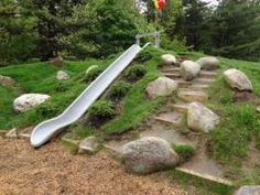The Natural Playgrounds Company built an embankment slide into a constructed hill at an elementary school in Glens Falls, N.Y. The embankmen...