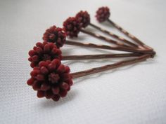 These #Chrysanthemum hair pins, in an array of colors, are sure to brighten up even your dreariest outfit with a beautiful floral accent.  Each flower is cast in colored res... #handmade #snowbunnystudios #chrysanthemum #shopsteam #mum #jewelry #pink #red #green #violet #steampunk #victorian