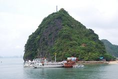 Ti Top island in Halong bay    Situated about 7-8 km south-east of Bai Cháy lies the small Ti Top Island. It displays a beach shaped like a crescent moon, and sand that has been washed to a snowy white by the tide. On 22 November 1962, this tiny island had the honour of receiving a visit from astronaut Gherma