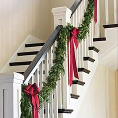 This is my favorite. I love garland with white twinkle lights and those big red bows! whether it's down the stairs, on the fence, or around your door I think it is so cute and is a very clean refreshing look.