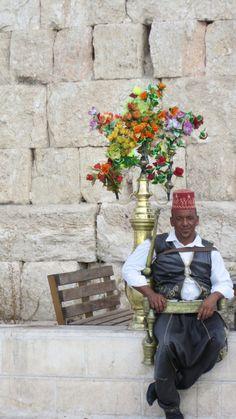 A Li-cherish drink seller in Jerash, Jordan a drink you must try when in Jordan.