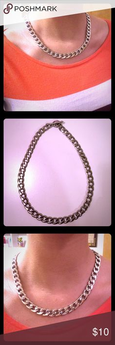 Charming Charlie chain-link style necklace. This gorgeous Charming Charlie necklace is both fierce and classy, chic and bold. Make a statement with this sleek, chain-link style necklace! Its smooth shine and silvery resplendence goes with any outfit and is sure to attract the attention of anyone with an eye for beauty. (Like-new condition; no rust, discoloring, etc.) Charming Charlie Jewelry Necklaces