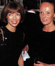 """Anna Wintour wearing a Gianni Versace Spring/ Summer 1994 """"safety pin"""" dress at an event with Grace Coddington"""
