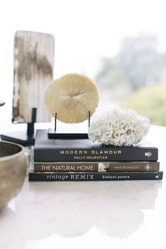 Susan Greenleaf San Francisco Home - Coral ephemera atop coffee-table books on a white surface Coffee Table Styling, Coffee Table Books, Decorating Coffee Tables, Home Decor Accessories, Decorative Accessories, Coffee Table Accessories, Books Decor, Decor Room, Wall Decor