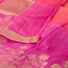 "The Half & half ""Pink & Orange"" body of this #handwoven Banarasi Dupion Silk Sari from Parisera is woven with gold zari floral motifs that is set off by a gold colour zari border on either side. An attractive gold colour zari floral motifs adorn the pink and orange pallu. The pink blouse completes the sari."
