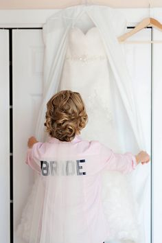 intricate up do & cute 'bride' shirt for those getting ready shots