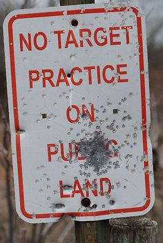 Obviously, they're practicing on the sign, not the land...  So, we're good.
