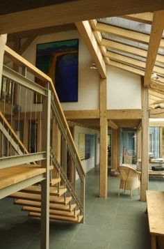 Fantastic double-height entrance hall with exposed oak frame and garden room to house in Oxford by Roderick James Architects