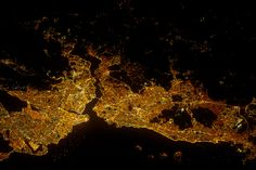 Most of Istanbul's Asian suburbs (image right) appear in this night view from the International Space Station, but only about half the area of the city on the European side is visible. The margins of the metropolitan area are clearly visible at night, more so than in daylight images in daylight images.