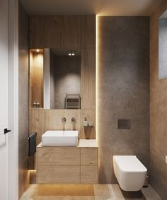 An open-concept minimalist home that mixes concrete, stone, wood, and metal to create a masculine and earthy interior design, including a modern black kitchen. Washroom Design, Modern Bathroom Design, Bathroom Interior Design, Modern Toilet Design, Earthy Bathroom, Small Bathroom, Master Bathroom, Minimalist Home Interior, Bathroom Layout