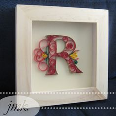 """Quilled R in Shadow Box Frame.    Pinspiration: http://www.behance.net/gallery/paper-typography/858836    Used 1/4"""" strips of card stock and Elmer's school glue. I would recommend actual quilling paper and a quilling tool for less paper cuts."""