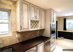 Cream cabinets with back splashes | cream cabinet travertine subway backsplash tile