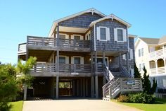 "# 443  ""Sandy Stepps""   Sandy Stepps Beautiful & spacious custom designed home located in prestigious Old Nags Head Place. Enjoy walking or biking along the quiet streets full of Old Nags Head charm. From the upper sun deck you can enjoy Ocean Views & a view of Jockey's Ridge."