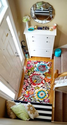 bright colored small entry foyer in a split entry with shoe storage.. Not the colors but love the idea