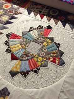 Beautiful machine quilting, and the patchwork pattern is lovely too.