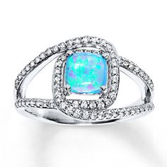 This show-stopping ring for her highlights a cushion-cut, lab-created blue opal accompanied by rows of twinkling lab-created white sapphires. The pretty ring is styled in sterling silver.
