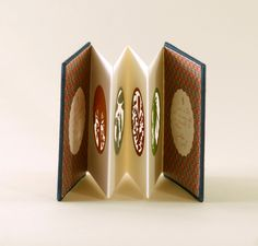 accordion with translucent windows - a miniature artist's book by elsa mora