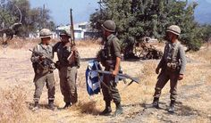Turkish soldiers in Northern Cyprus during Operation Attila with a captured Greek flag. July 1974.