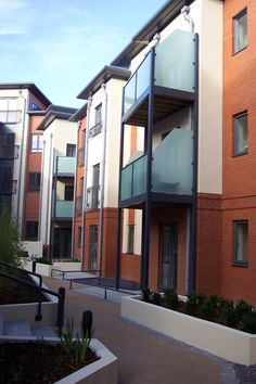 Walk-out design glass faced balcony systems with frosted privacy glazing in Birmingham.