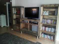 Our entertainment center by Allen.. covered in old pallets