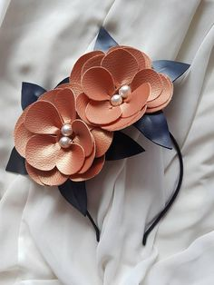 Navy and rose gold synthetic leather flower headpiece / fascinator / headband ideal for a wedding or the races