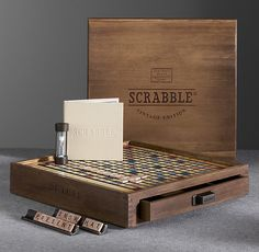 VINTAGE EDITION SCRABBLE®  $199SPECIAL $139   In the 1930s, during the Great Depression, an unemployed architect named Alfred M. Butts invented a board game using letter tiles and a scoring system. He first called it Lexico, then Criss Cross Words, but it was in 1948, when he teamed with entrepreneur James Brunot, that the name Scrabble® was born. The game's wild popularity began in the '50s and continues today. Over 100 million Scrabble games have been sold worldwide.