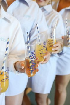 Wedding Getting Ready Photo with Bridesmaids in Nightshirts with Personalized Mimosa Glasses