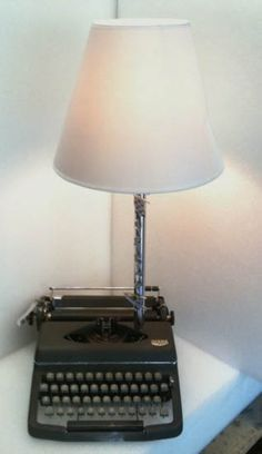 Unique table lamp.. what a convenient place for it... at least you can see when you type... Wait the typewriter is out dated.