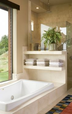 Shelving between the foot of the bath and the shower