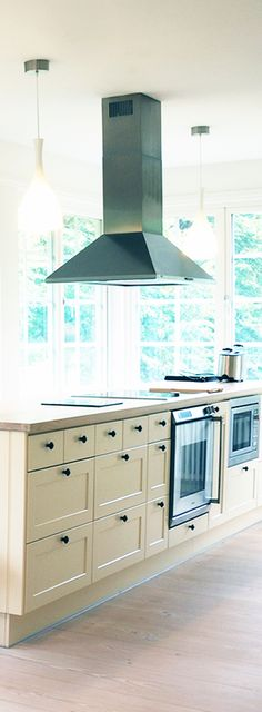 Stainless Steel Island Range Hood from Proline Range Hoods. Butter yellow cabinets. Big Kitchen Windows. Kitchen Pendant Lighting. Stainless Steel Appliances. Vent Hood. View Our Range hood Selection: Prolinerangehoods.com