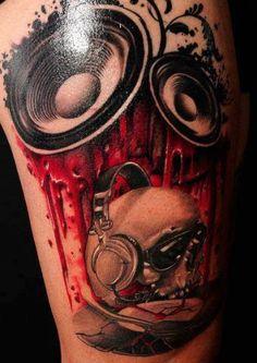 Speaker skull tattoo